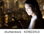young woman looking at mobile... | Shutterstock . vector #425822413