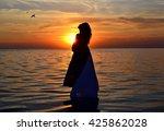women in white sheet at sunset.   Shutterstock . vector #425862028