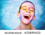 laughing kid with paint stained ... | Shutterstock . vector #425890420