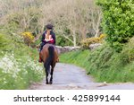 Young Woman Riding Horse Up A...