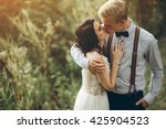 bride and groom kissing in the...   Shutterstock . vector #425904523
