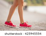 running woman during sunny day... | Shutterstock . vector #425945554
