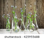 forget me nots in glass bottles.... | Shutterstock . vector #425955688