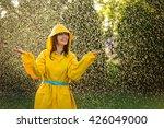 happy woman wearing yellow... | Shutterstock . vector #426049000