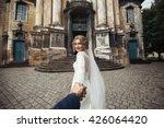 beautiful stylish bride leading ... | Shutterstock . vector #426064420