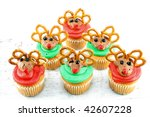 Cupcakes decorated to look like Rudolph.  Shot on a rustic white background with room for text. - stock photo