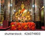 Praying Monks At Wat Xieng...