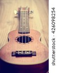 Small photo of ukulele on wood background
