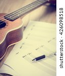 Small photo of Ukulele and musical paper notes