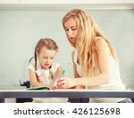 parent teaches a child to write.... | Shutterstock . vector #426125698
