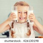 child drinking milk at home.... | Shutterstock . vector #426130198