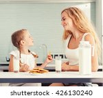 child with mother drinking milk.... | Shutterstock . vector #426130240