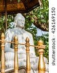 A Stone Statue Of Buddha Under...