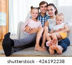 relaxed happy family of four... | Shutterstock . vector #426192238