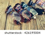 Different Sunglasses On Wooden...