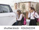 two cute schoolgirls getting in ... | Shutterstock . vector #426262234