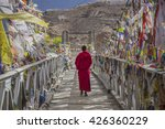 a monk walks on the bridge... | Shutterstock . vector #426360229