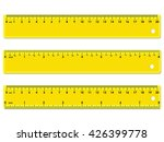 set of three yellow rulers ...