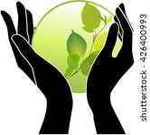 hands holding green plants in a ... | Shutterstock .eps vector #426400993