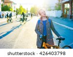 young stylish woman and bike in ... | Shutterstock . vector #426403798