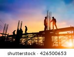 Silhouette engineer standing orders for construction crews to work on high ground  heavy industry and safety concept over blurred natural background sunset pastel - stock photo