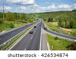 red and black cars on an... | Shutterstock . vector #426534874