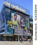 Small photo of BEIJING, CHINA - OCTOBER 1, 2015: People are seen around a Adidas store; Adidas, a German multinational corporation founded in 1948, is the second biggest sportswear manufacturer in the world.