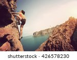 young woman rock climber... | Shutterstock . vector #426578230