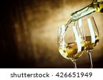 pouring two glasses of white... | Shutterstock . vector #426651949