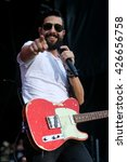 Small photo of KISSIMMEE, FL-MAR 18: Singer Matt Ramsey of Old Dominion performs onstage at the Runaway Country Music Fest at Osceola Heritage Park on March 18, 2016 in Kissimmee, Florida.