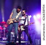 Small photo of KISSIMMEE, FL-MAR 18: Singer Matt Ramsey (R) & guitarist Brad Tursi of Old Dominion performs onstage at the Runaway Country Music Fest at Osceola Heritage Park on March 18, 2016 in Kissimmee, Florida.