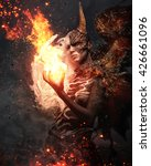 devil woman with horn in a fire. | Shutterstock . vector #426661096