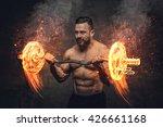 Muscular Shirtless Male Doing...