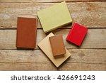 pile of books on wooden... | Shutterstock . vector #426691243