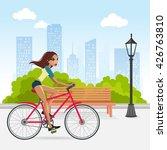 woman cycling in public park   Shutterstock .eps vector #426763810