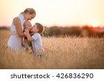 happy family enjoying sunset in ... | Shutterstock . vector #426836290