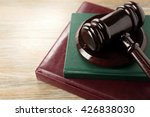gavel and books on wooden