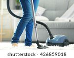Woman Cleaning The Carpet With...