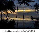 Reflected Sunrise Scene On The...