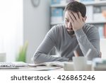 exhausted young man working at... | Shutterstock . vector #426865246