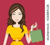smile woman shopping bag vector   Shutterstock .eps vector #426884128