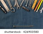 wrench tools on a denim workers ... | Shutterstock . vector #426903580