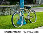 bicycle on the green grass.... | Shutterstock . vector #426969688
