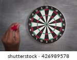 Small photo of A man throw a Plastic tip Dart ,Target aim symbol of goal , business concept