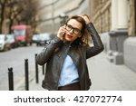 businesswoman walking down the... | Shutterstock . vector #427072774