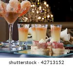 Asian Fusion appetizers with prawn cocktails, tuna, peking duck spring rolls and soups. - stock photo