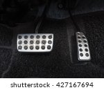 Small photo of Brake pedal and accelerator pedal in car , close up