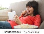 attractive woman relaxing on... | Shutterstock . vector #427193119