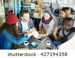 group of friends sitting at... | Shutterstock . vector #427194358