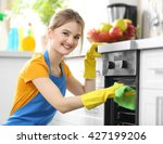cleaning concept. woman washes... | Shutterstock . vector #427199206